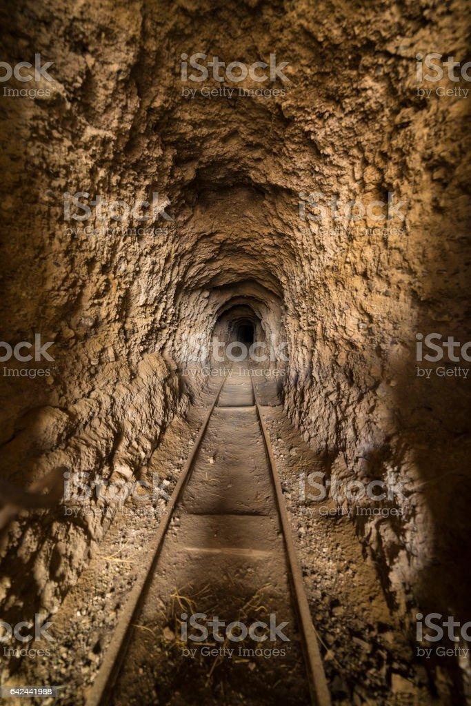 Inside abandoned gold mine tunnel or shaft in the Nevada desert. stock photo