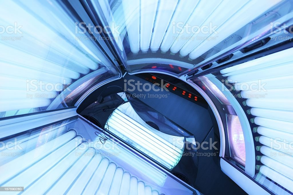 Inside active tanning bed stock photo