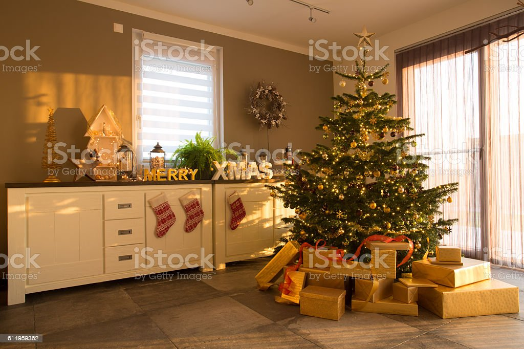 inside apartment decorated for christmas stock photo
