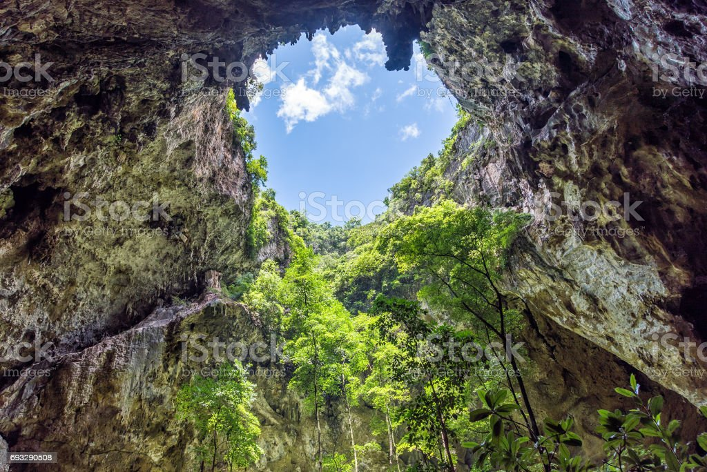 Inside cave with sunlight through hole on cave ceiling. Phraya Nakhon cave in Khao Sam Roi Yot National Park. stock photo