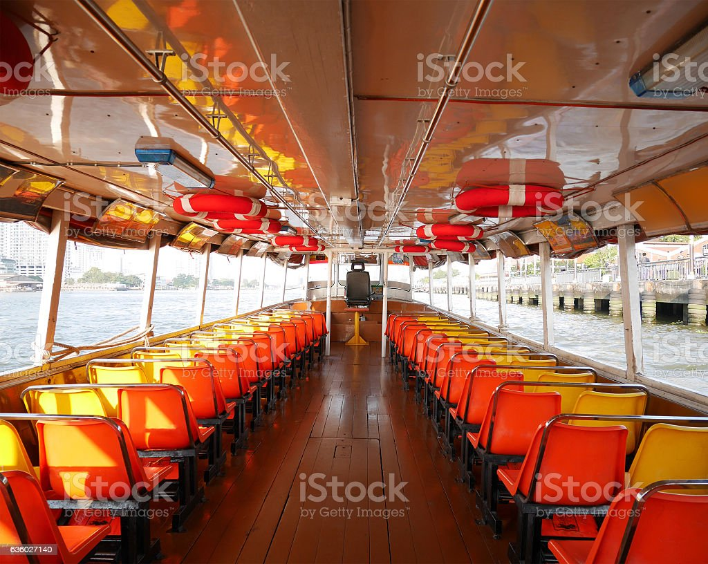 Inside Chao Phraya river express boat stock photo