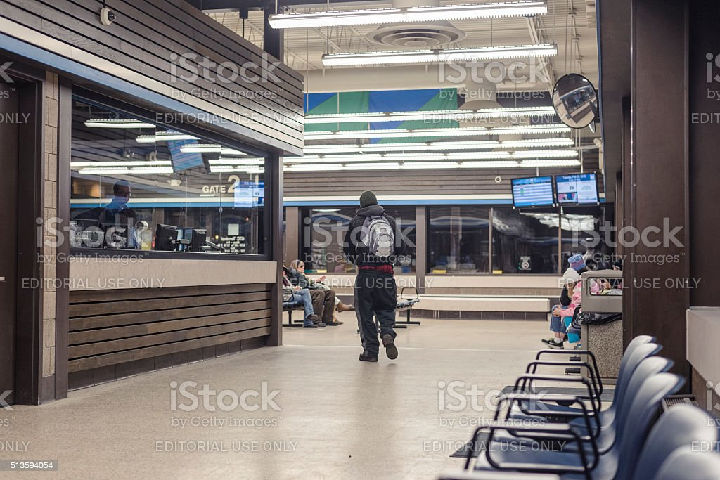 Inside Fargo's bus station during night with few people stock photo