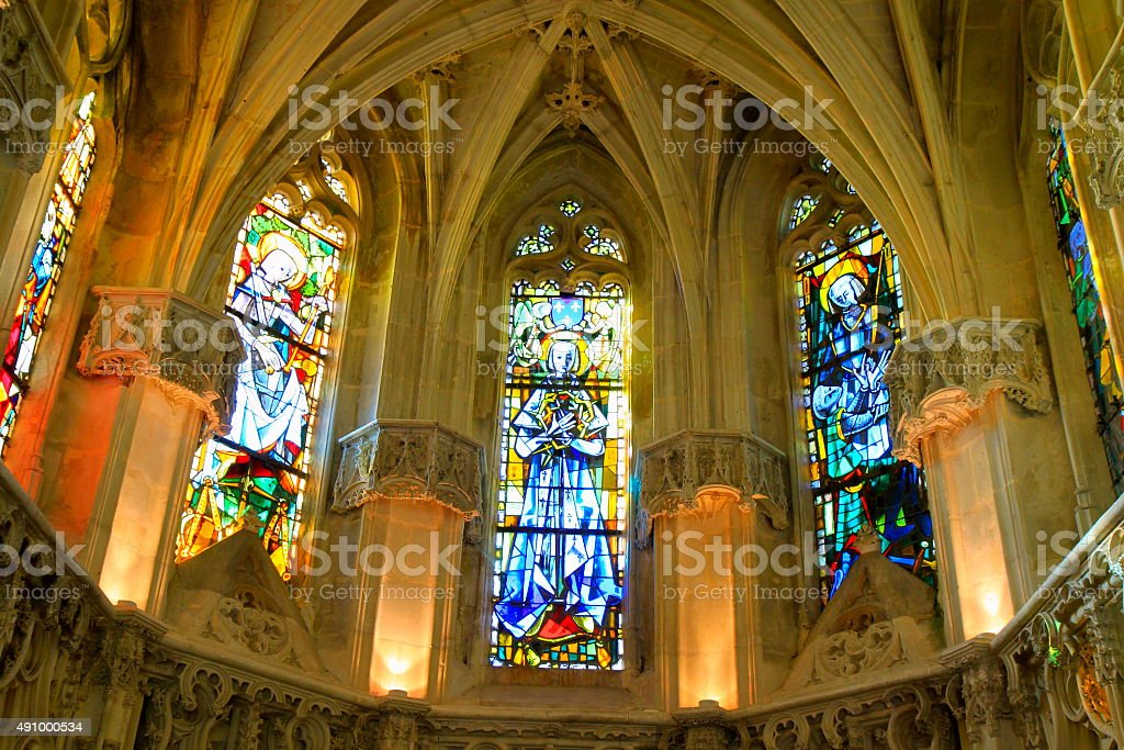 Inside gothic French chapel church, vitrals, Loire Valley stock photo