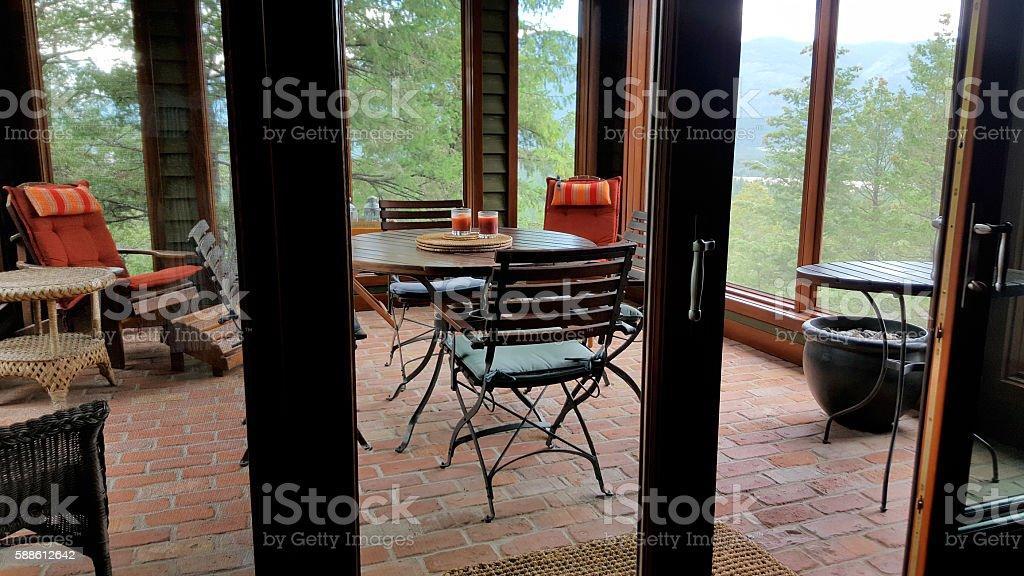 Inside Looking Out To Upscale Residential Screened In Porch stock photo