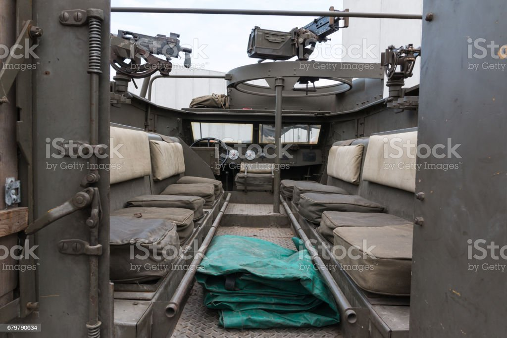 Inside Military Track: Seats and Submachine Guns stock photo