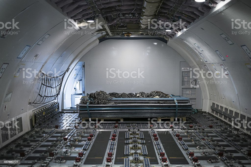 Inside of a cargo aircraft carrier with a stack of metal stock photo