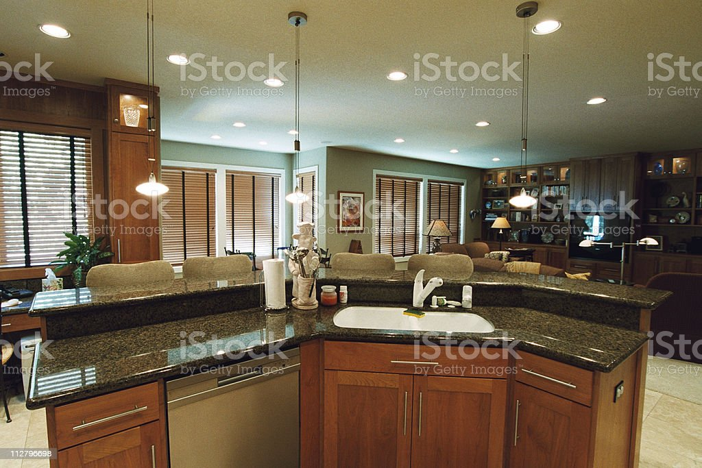 Inside of a Modern Kitchen with stainless steel appliances stock photo