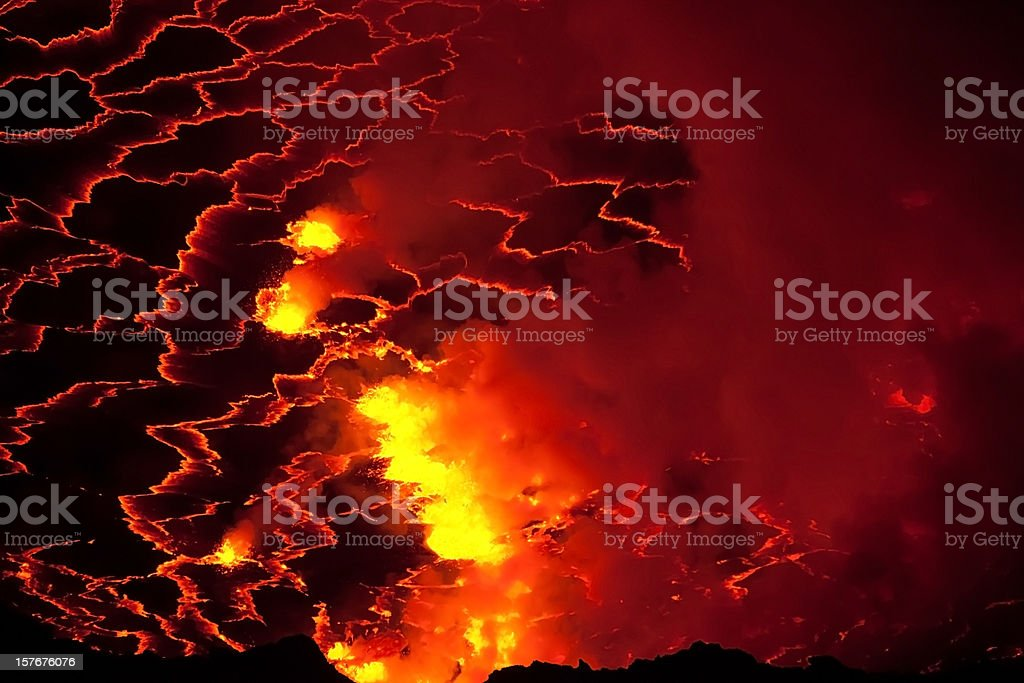 Inside of a volcano crater filled with boiling lava stock photo