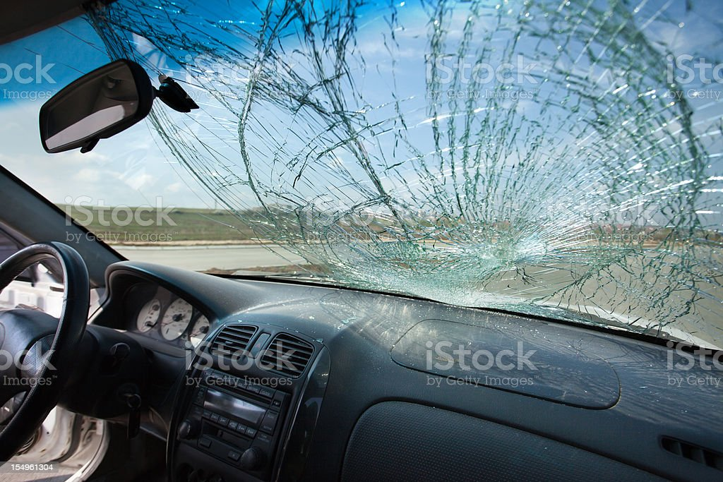 Inside of car with the broken windshield. Road accident stock photo