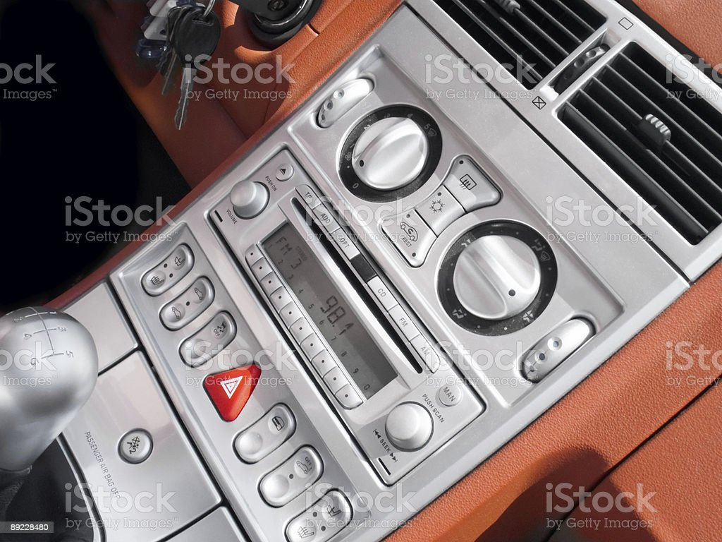 Inside of interior automobile console in silver and orange colors royalty-free stock photo