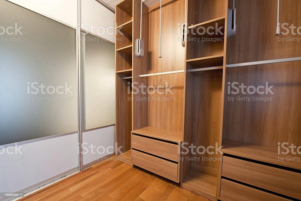 Inside of big modern walk-in wardrobe
