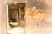 Inside Old Ruined House: Doorways and Mottled Orange Walls