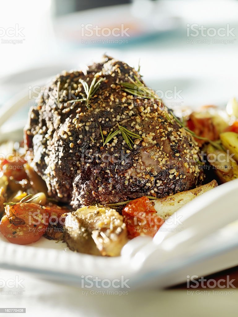 Inside Round Beef Roast with Roasted Tomatoes royalty-free stock photo