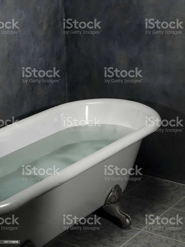 Inside the old bathtub full of water stock photo