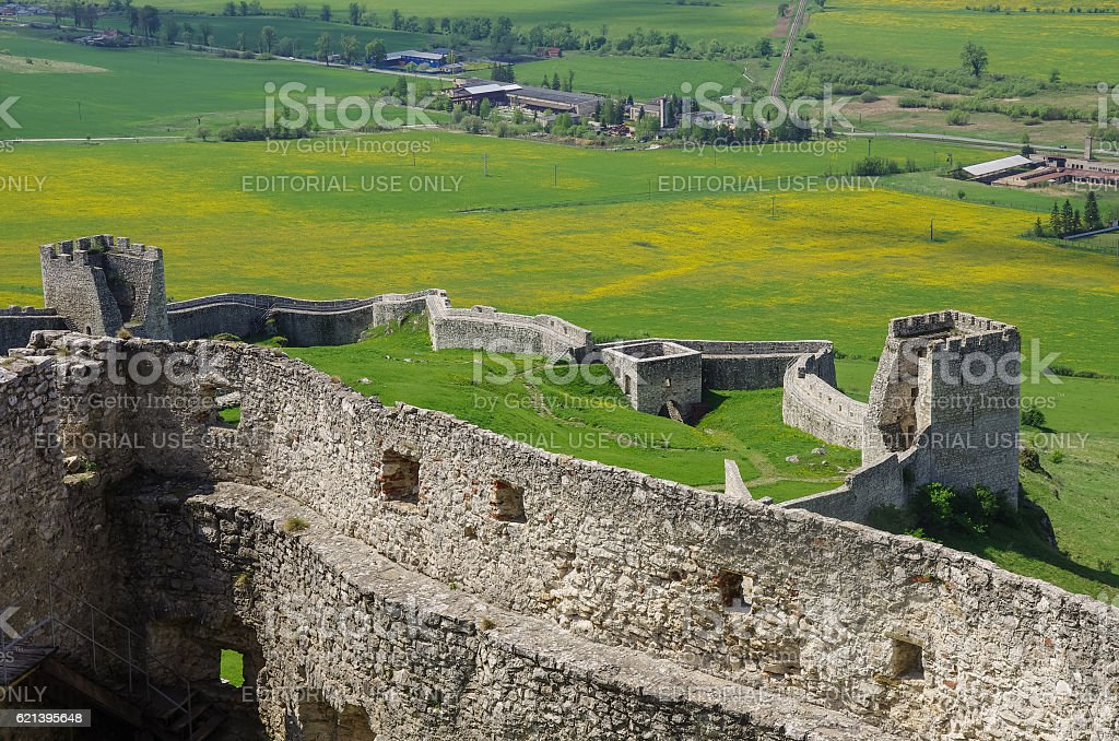 Inside the walls of Spis Castle with panorama of meadows stock photo