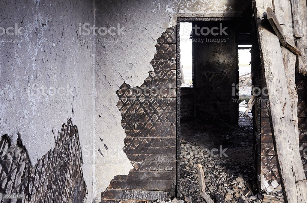 inside view door burned down house stock photo