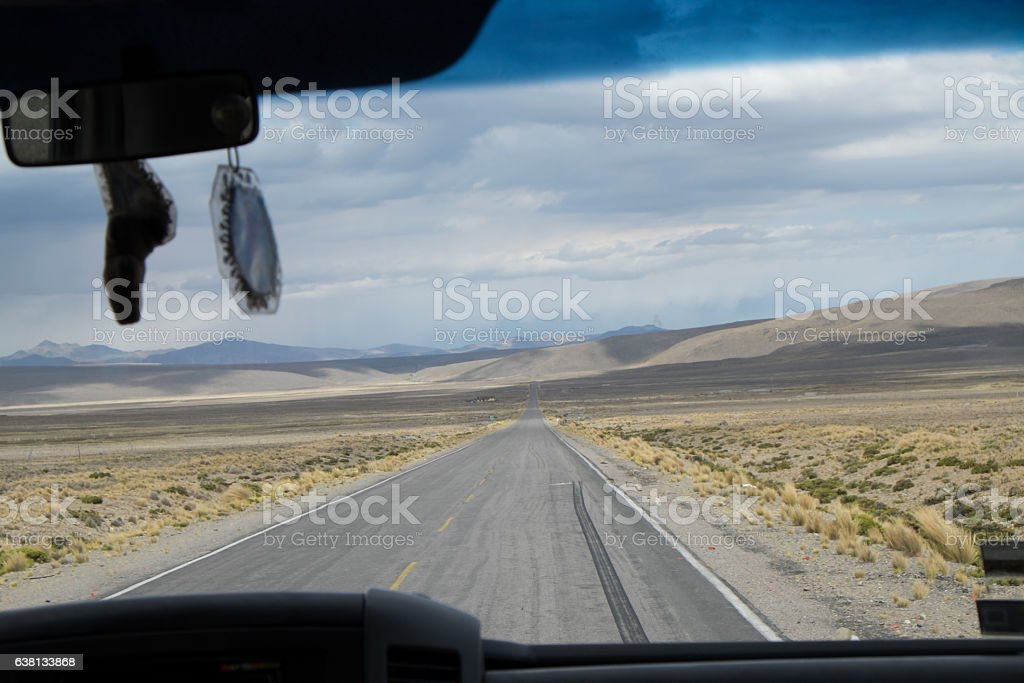Inside view of a  car Crossing the Desert of Perù stock photo