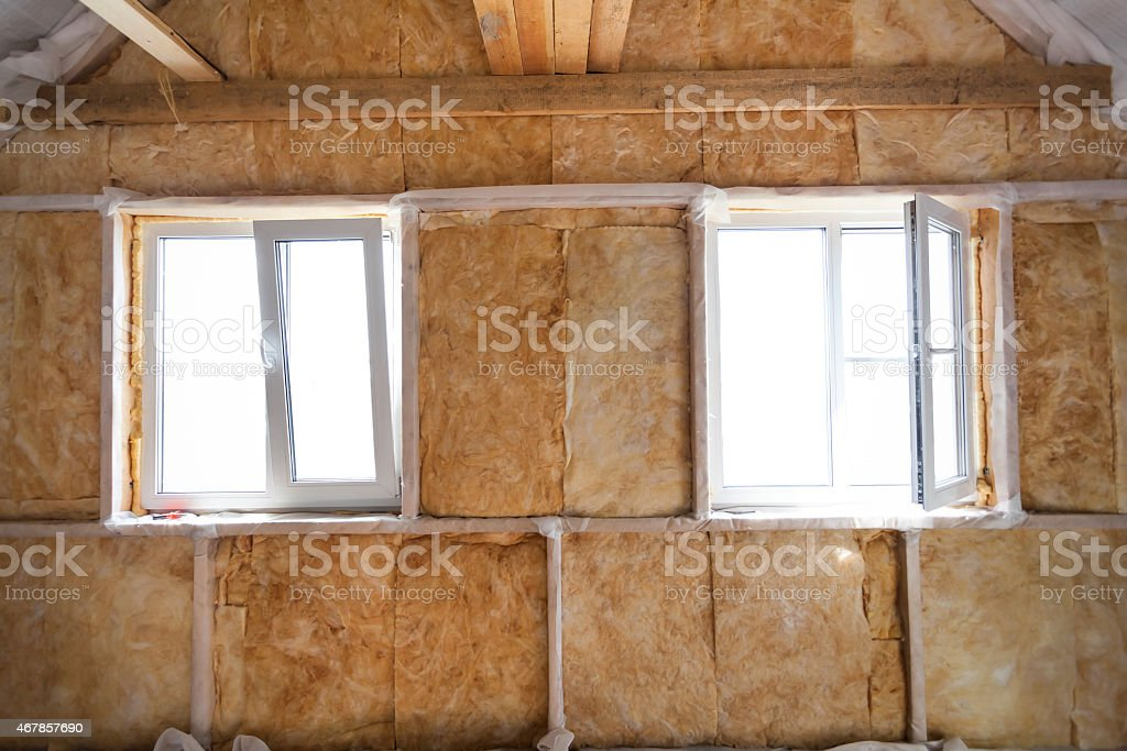 Inside wall heat isolation with mineral wool in wooden house stock photo