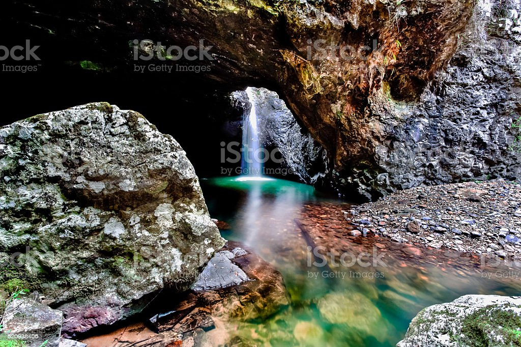 Inside waterfall of cave from natural bridge in Australia stock photo