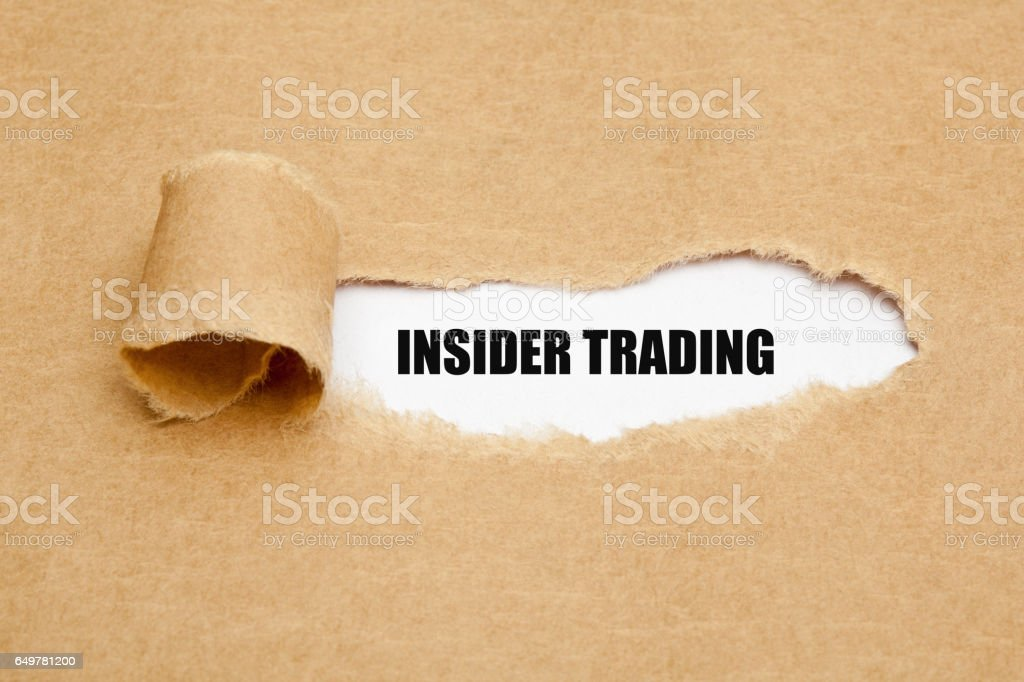 Insider Trading Torn Paper Concept stock photo