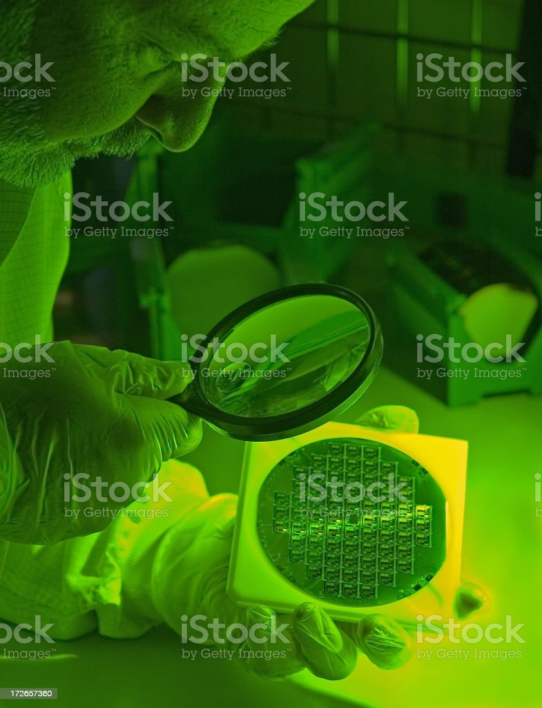 Inspecting a Silicon Wafer royalty-free stock photo