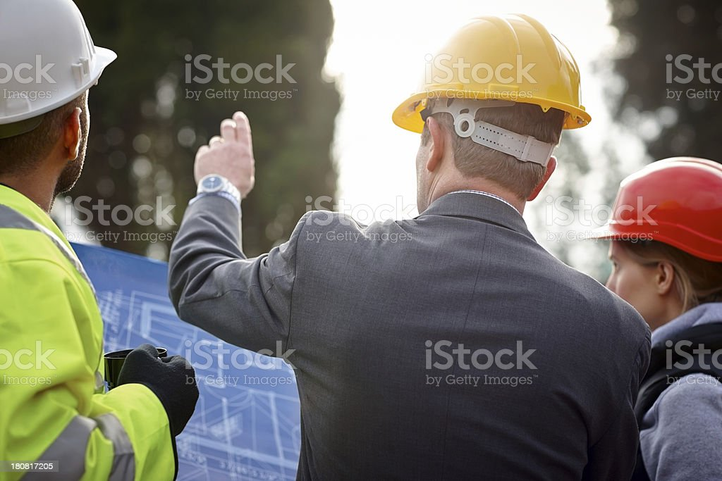 Inspecting construction site stock photo