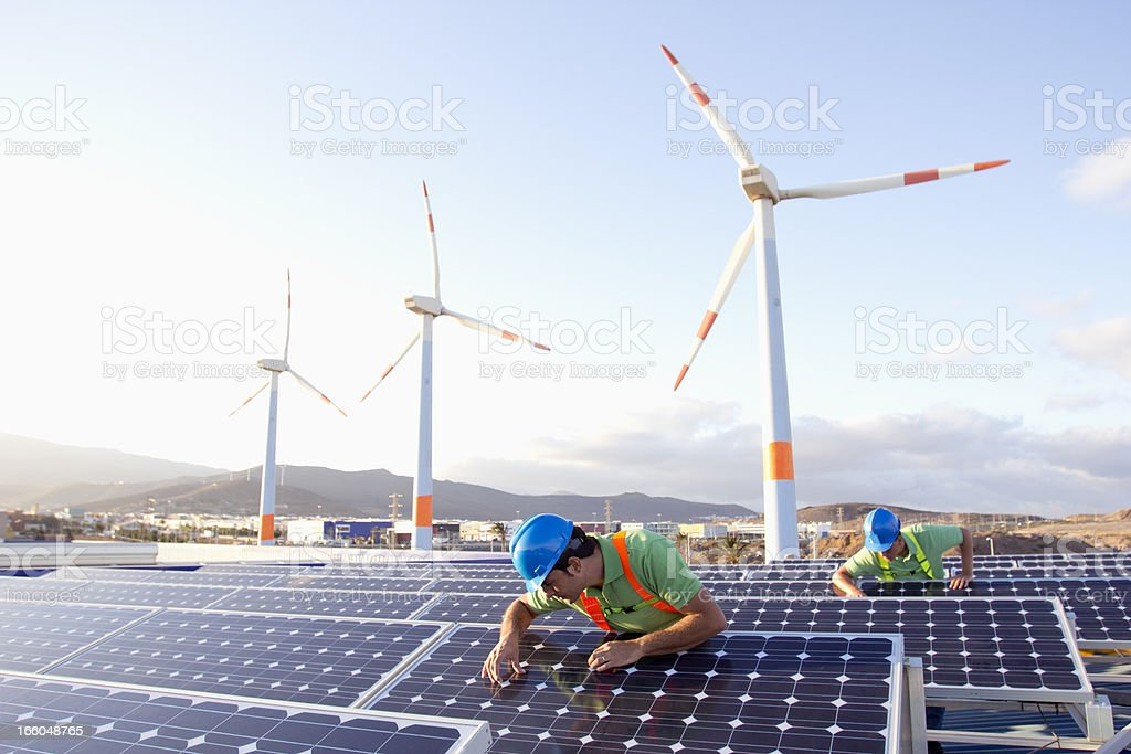 Inspecting photovoltaic panels stock photo