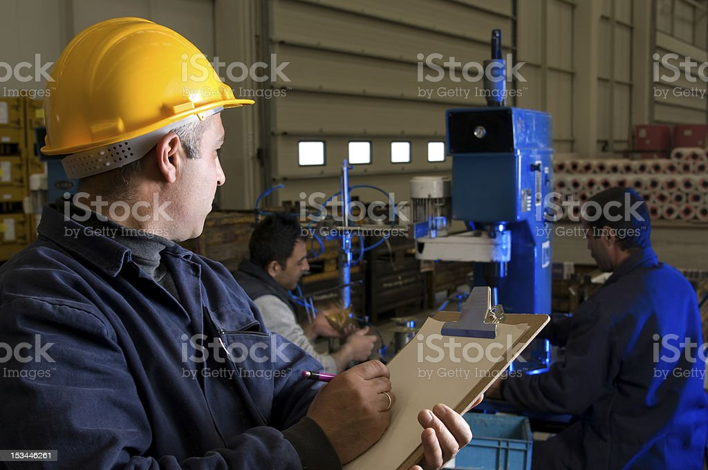 Inspecting royalty-free stock photo