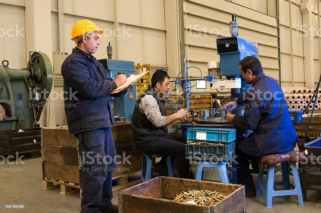 Inspecting Workers royalty-free stock photo
