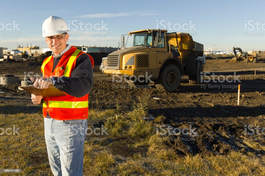 Inspector and Dump Truck stock photo