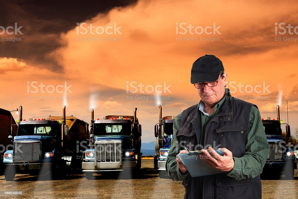 Inspector and Trucks, California stock photo