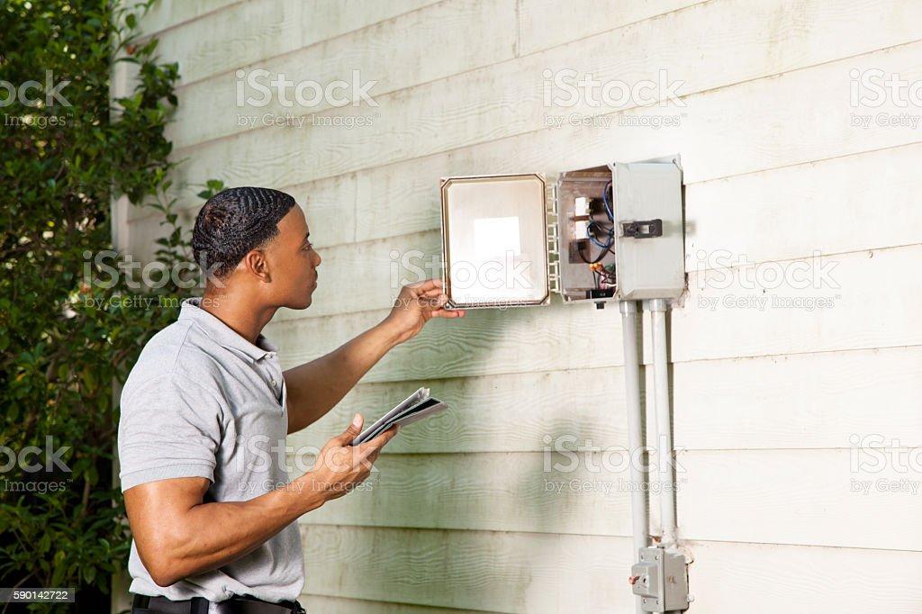 Inspector, engineer examines building outdoors. stock photo