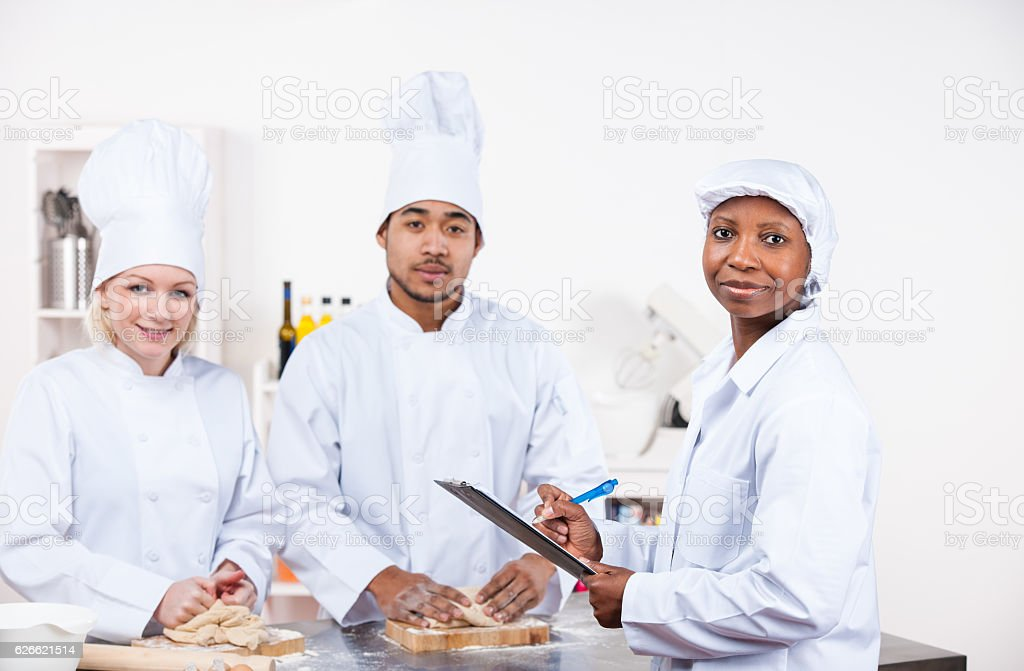 Inspector Impressed With  Inspection In A Commercial Kitchen stock photo
