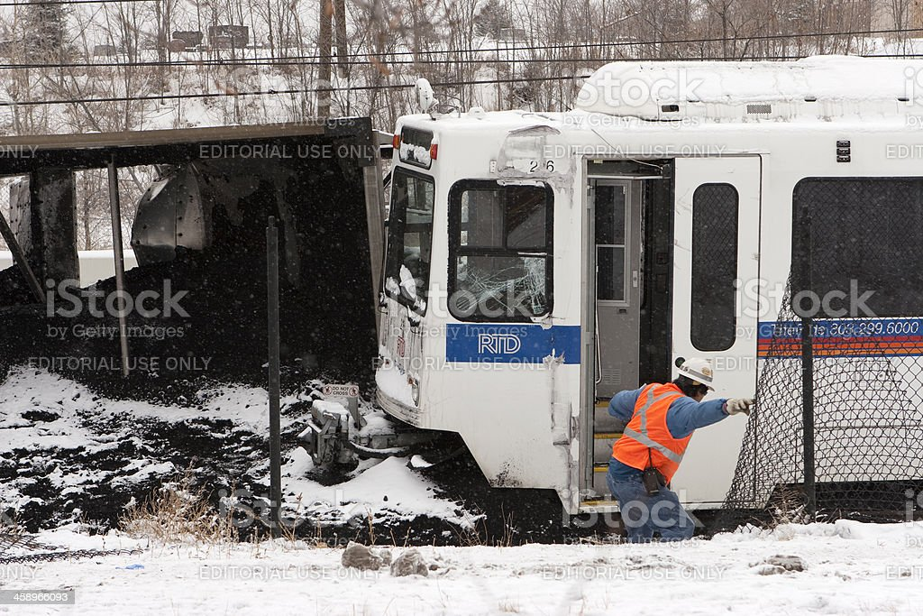Inspector looks at crashed light rail and coal trains Colorado stock photo