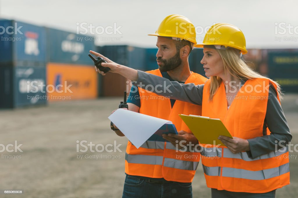 Inspectors checking cargo containers stock photo