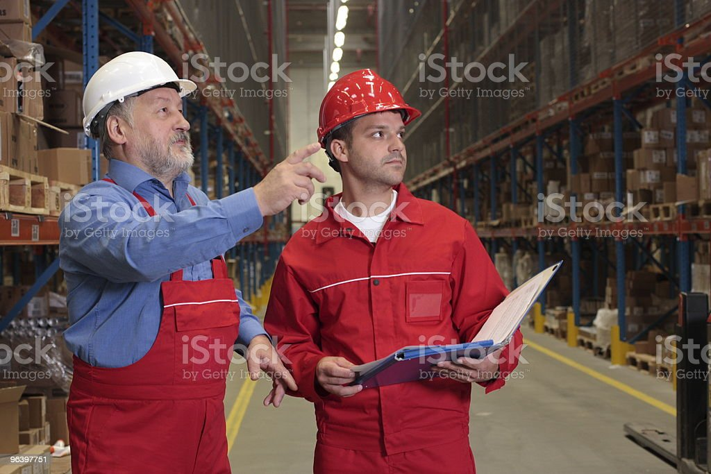 Inspectors in warehouse royalty-free stock photo
