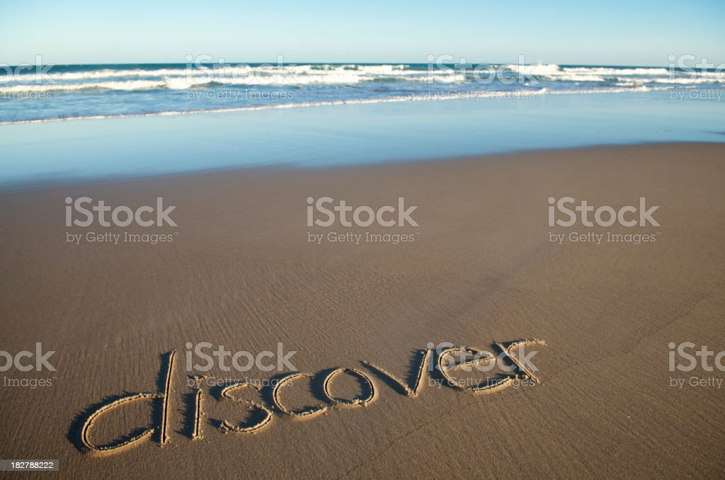 Inspiration Discover Message Handwritten on Empty Beach royalty-free stock photo