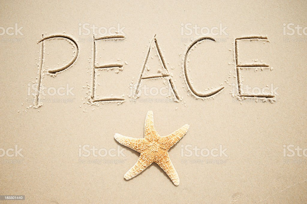 Inspirational Holiday Greeting Message of Peace Handwritten Starfish in Sand royalty-free stock photo