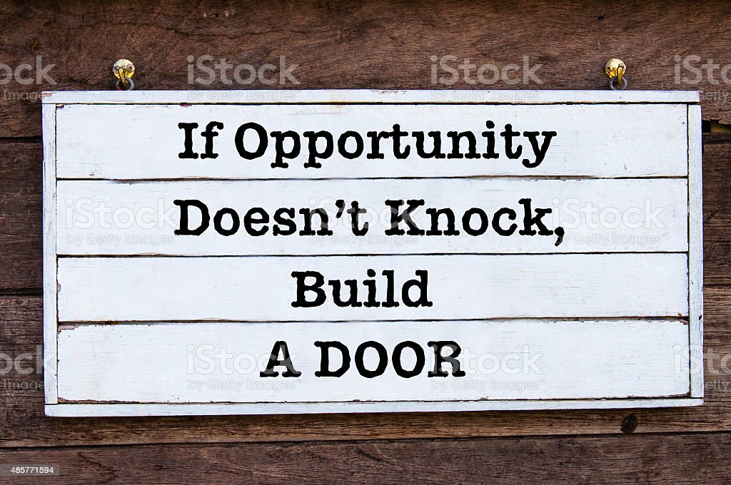 Inspirational message - If Opportunity Doesn't Knock, Build a Door stock photo