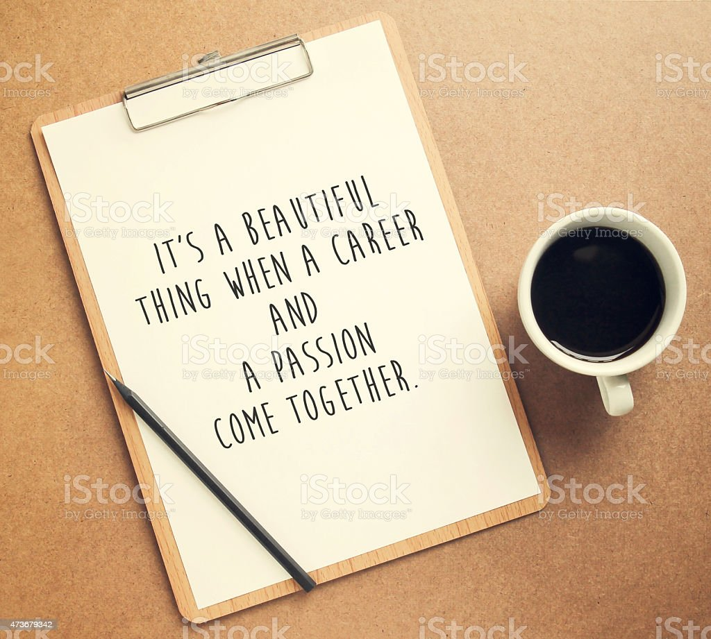 Inspirational motivating quote on clipboard and cup of coffee stock photo