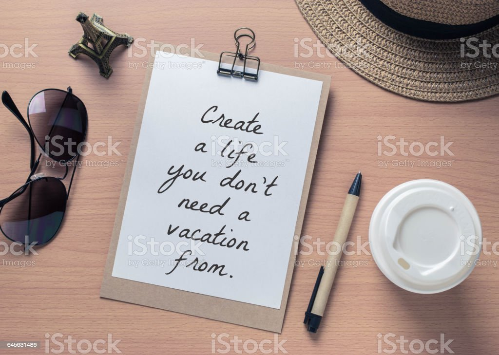 Inspirational motivating quote on notebook and travel objects with vintage filter stock photo