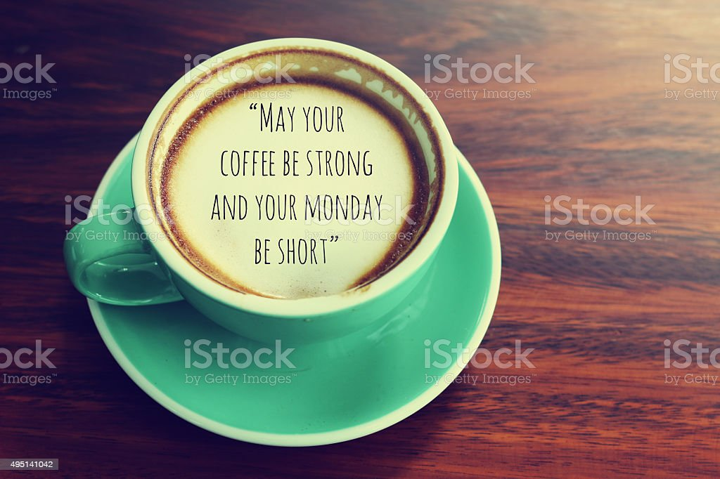 Inspirational quote on coffee cup background with vintage filter stock photo