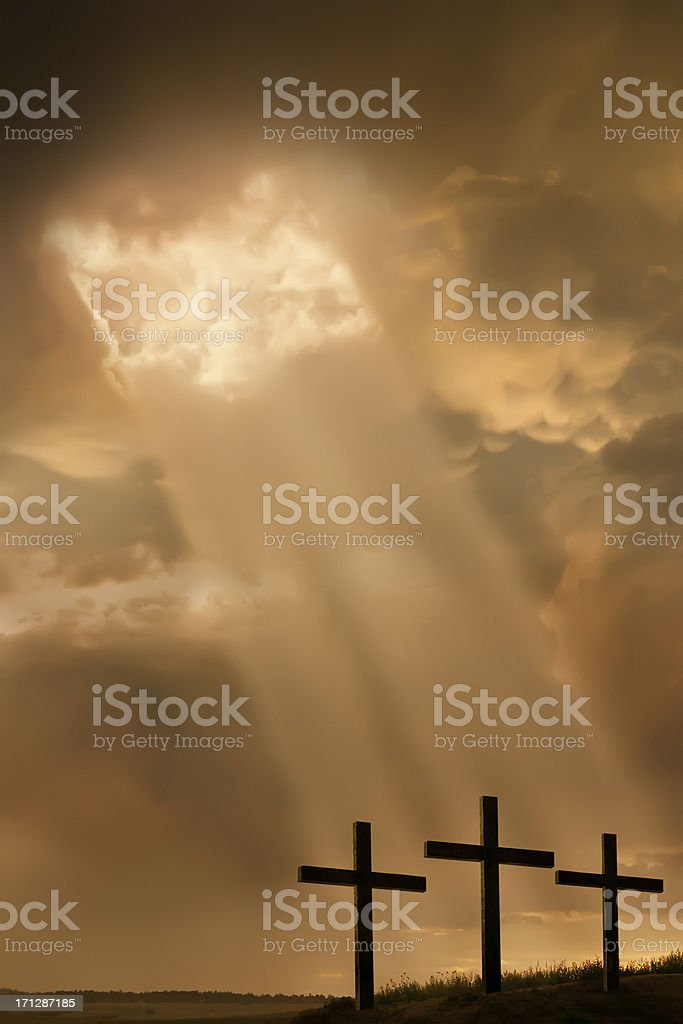 Inspirational Religous Illustration Breaking Storm Light Beams and Three Crosses stock photo