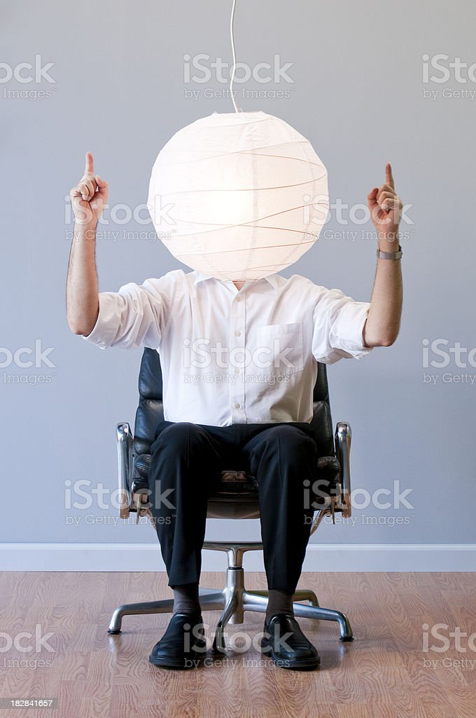 Inspired Man with An Idea Sitting In Office Chair. stock photo