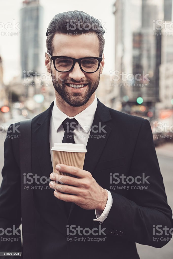 Inspired with cup of fresh coffee. stock photo