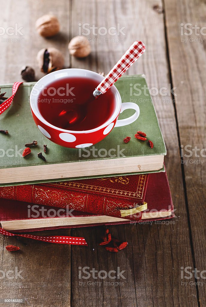 Instagram looking picture of cup of tea and vintage books stock photo