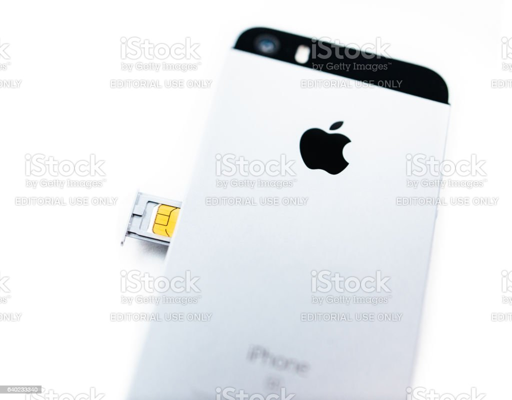 Instalation of the new SIM new iPhone SE stock photo