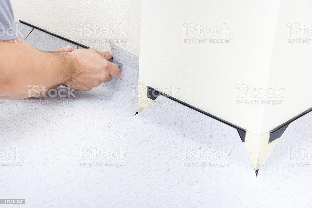 Instaling PVC Floor royalty-free stock photo