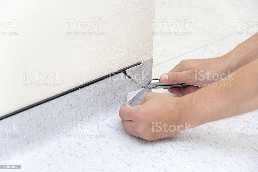 Instaling PVC Floor stock photo