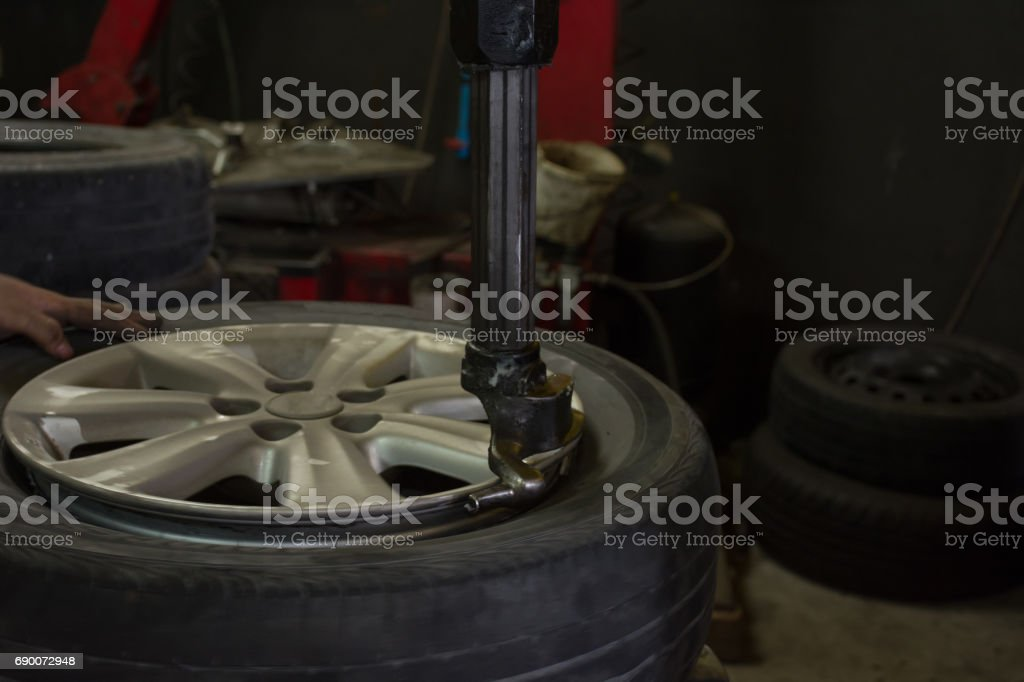 Install a new car wheel on tyre remover machine stock photo